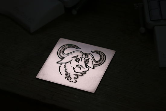 FSF RMS GNU – Logo on PCB with RGB LEDs and logo lasered in stone